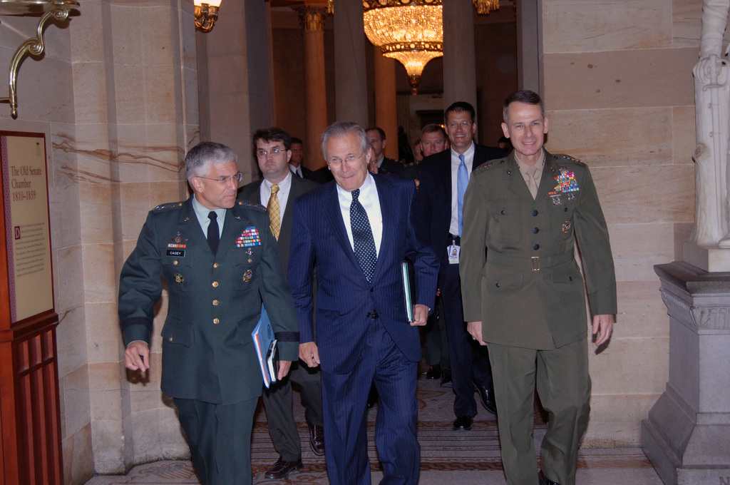 U.S. Army Gen. George W. Casey, Jr. (left), Commanding General, Multi-National Force - Iraq; the Honorable Donald H. Rumsfeld (center), U.S. Secretary of Defense; and U.S. Marine Corps Gen. Peter Pace (right), Chiarman of the Joint Chiefs of STAFF; walk together to a meeting on Capitol Hill in Washington, District of Columbia, on June 21, 2006. (U.S. Army photo by STAFF SGT. Gary Hillard) (Released)