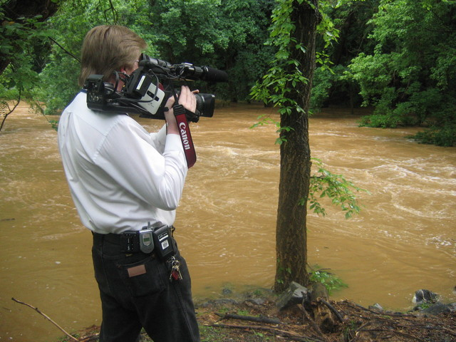 [Severe Storms, Flooding, and Tornadoes] Germantown, MD, June 27, 2006 -- FEMA Broadcast Operations Manager Paul Luke shoots video of flood waters and damage along Seneca Creek as record rains continue to fall across the Mid-Atlantic region. Aaron Skolnik/FEMA
