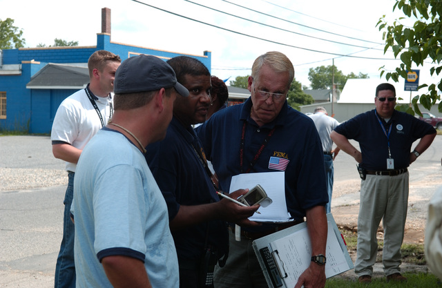 Federalsburg, MD, June 28, 2006 -- A FEMA Individual Assistance (IA) Damage Assessment Team examines private property that was damaged by 4 days of heavy rain and flood waters so they can make a disaster declaration recommendation.  FEMA/Bill Koplitz