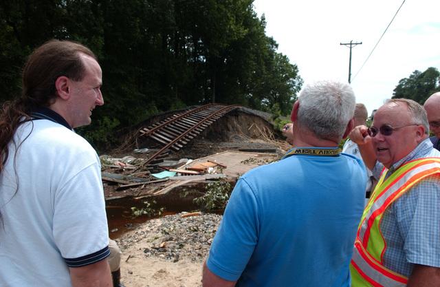 Federalsburg, MD, June 28, 2006 -- A FEMA Public Assistance (PA) Damage Assessment Team examines rail road tracks that were damaged by 4 days of heavy rain and flood waters.  FEMA/Bill Koplitz