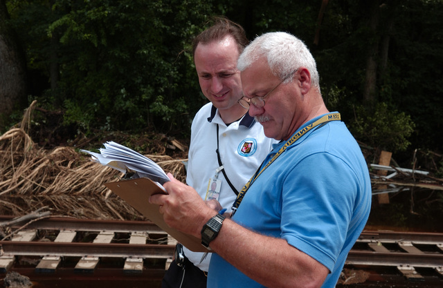 Federalsburg, MD, June 28, 2006 -- A FEMA Public Assistance (PA) Damage Assessment Team at the site of damage to a rail road line.  4 days of heavy rain flooded creeks and damaged several roads and bridges in the area.  FEMA/Bill Koplitz