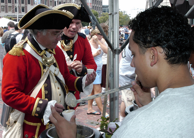 Two re-enactors dressed in revolutionary war period uniforms sample some clam chowder from the US Navy (USN) Wasp Class Amphibious Assault Ship, USS KEARSARGE's (LHD 3) S-2 Food Service Division, during the annual Boston Harborfest's Chowderfest. KEARSARGE is in Boston, Massachusetts (MA), participating in activities and events of the annual Harborfest