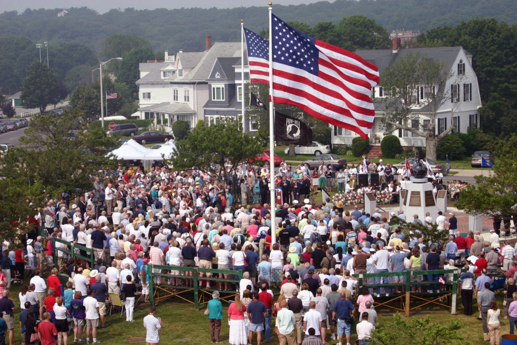 A US Navy (USN) Color Guard from the USN Wasp Class Amphibious Assault Ship USS KEARSARGE (LHD 3) presents the Colors as a crowd stand up while the National Anthem is played before a fireworks display at the Esplanade on the Charles River in Boston.  The KEARSARGE is participating in the annual Fourth of July celebration Boston Harborfest 2006 which is attended by more than two million people