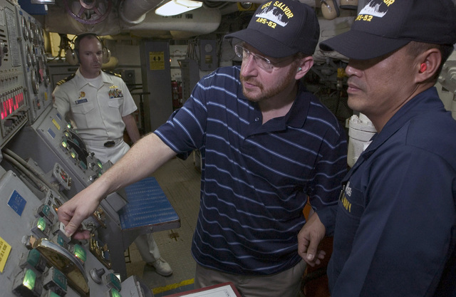 Mister Seth Winnick (center), Consulate General of the United Sates in Ho Chi Minh City, Vietnam (VNM), starts the diesel engines of the USN Safeguard Class Salvage Ship USS SALVOR (ARS 52) under the guidance of USN CHIEF Engineman Larry Rafanan (right) during their visit in Ho Chi Minh City, Vietnam (VNM). During their stay, the USN Sailors will interact with the Vietnamese people through a variety of events, including a community service project at a local orphanage. Visits to Vietnam by USN ships symbolize the continuation of relations between the two nations
