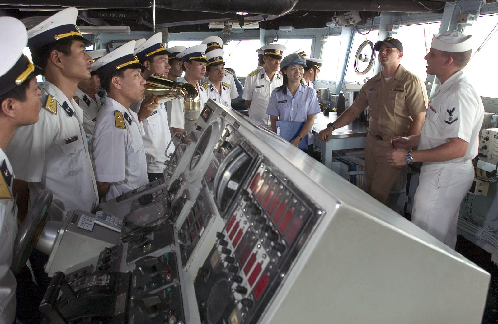US Navy (USN ) Quartermaster Third Class (QT3) Robert Arredondo talks to People's Army of Vietnam (PAVN) members from the bridge of the USN Safeguard Class Salvage Ship USS SALVOR (ARS 52) during their visit in Ho Chi Minh City, Vietnam (VNM). During their stay, the USN Sailors will interact with the Vietnamese people through a variety of events, including a community service project at a local orphanage. Visits to Vietnam by USN ships symbolize the continuation of relations between the two nations