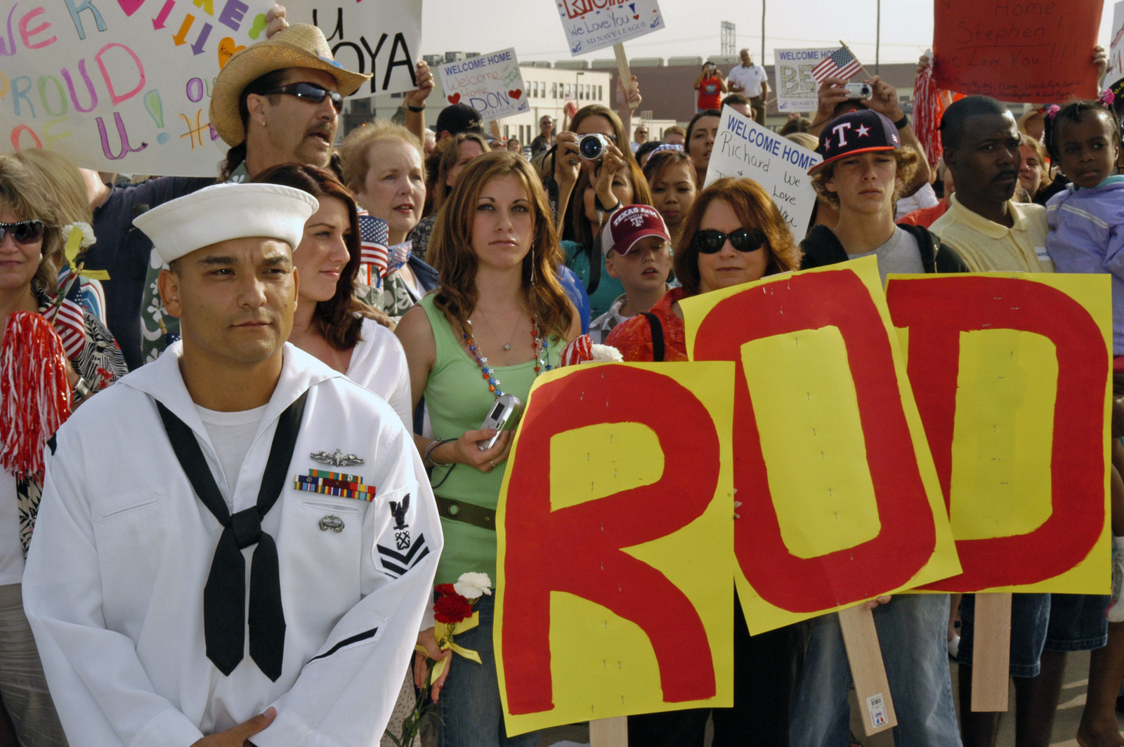 USN Navy (USN) Boatswain Mate First Class (BM1) Nicholas Hurcado (left) awaits orders to let family and friends greet their loved ones aboard the USN Arleigh Burke Class (Flight 1) Guided Missile Destroyers USS DECATUR (DDG 73) during a homecoming celebration at Naval Station (NS) San Diego, California (CA). The DECATUR and Carrier Strike Group (CSG) 7 completed a regular scheduled six-month deployment in support of the Global War on Terrorism (GWOT) and Maritime Security Operations (MSO)