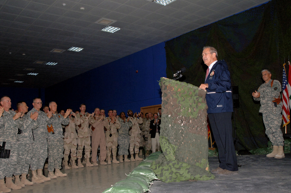 The Honorable Donald H. Rumsfeld (at the lectern), U.S. Secretary of Defense, speaks to U.S. Army Soldiers at a Town hall meeting at Balad Air Base, Salah Ad Din Province, Iraq, on July 12, 2006, during Operation Iraqi Freedom. (U.S. Army photo by STAFF SGT. Gary Hillard) (Released)