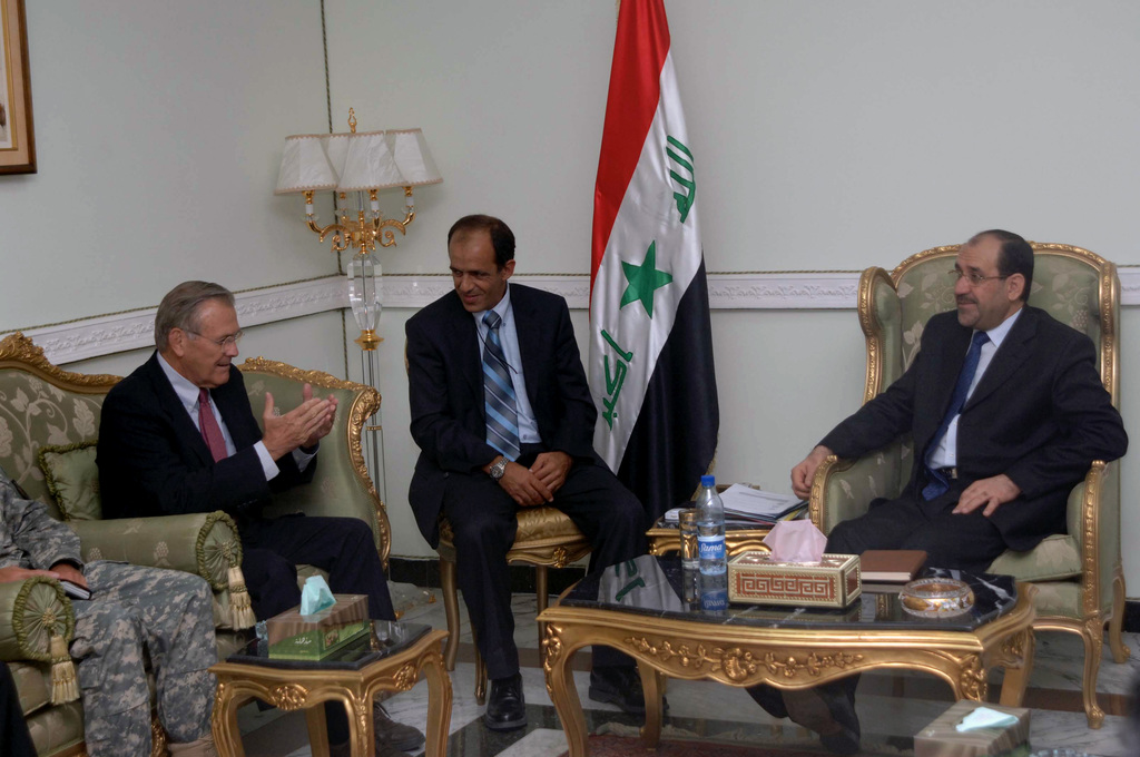 The Honorable Donald H. Rumsfeld (left), U.S. Secretary of Defense, speaks with Prime Minister Nouri Maliki (right) on July 12, 2006, about the progress of the war on terrorism in Iraq. (U.S. Army photo by STAFF SGT. Gary Hillard) (Released)