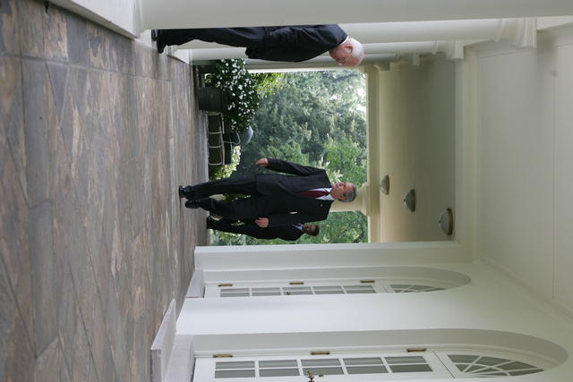 President Bush and Vice President Cheney Walk Through the White House Colonnade