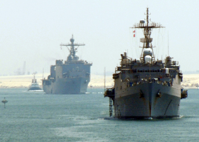 The US Navy (USN) Whidbey Island and Harpers Ferry Class Dock Landing Ship USS WHIDBEY ISLAND (LSD 41) (front) and the USN Austin Class Amphibious Transport Docks Ship USS TRENTON (LPD 14) (back) transit through the Suez Canal, Egypt (EGY), with the USN Wasp Class Amphibious Assault Ship USS IWO JIMA (LHD 7) Expeditionary Strike Group (ESG). (SUBSTANDARD)