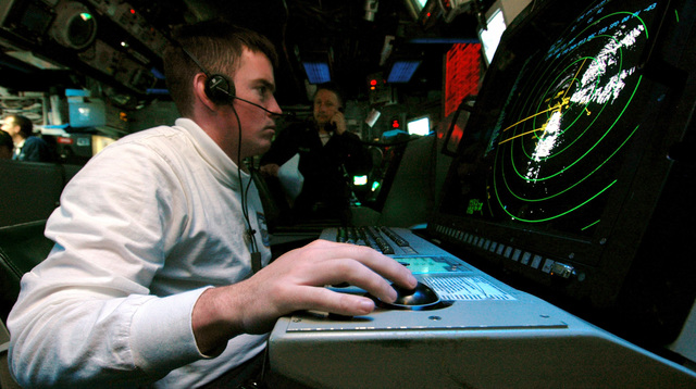 US Navy (USN) Air Traffic Controller Third Class (AC3) Jesse Henson monitors the radar in the Amphibious Air Traffic Control Center (AATCC), aboard the USN Wasp Class Amphibious Assault Ship USS IWO JIMA (LHD 7), while the USS IWO JIMA is off the coast of Beirut, Lebanon (LBN), assisting American citizens as they arrive onboard after being evacuated from Lebanon