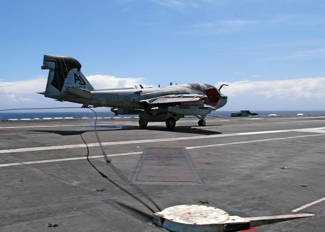 A US Navy (USN) EA-6B Prowler electronic warfare aircraft with Electronic Attack Squadron 141 (VAQ-141), makes an arrested landing on the USN Nimitz Class Aircraft Carrier USS THEODORE ROOSEVELT (CVN 71), in support of the Fleet Response Plan (FRP)