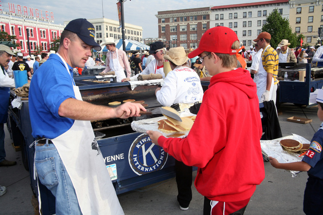 060724-N-3271W-002 (Jul. 24, 2006)US Navy (USN) CHIEF of the Boat SENIOR CHIEF Electronics Technician (ETCS) Robert Gleason, Ohio Class Submarine USS WYOMING (SSBN 742), flips pancakes to a young boy, during Frontier Days in conjunction with Navy Week at Cheyenne, Wyoming (WY).U.S. Navy official photo by CHIEF Mass Communication SPECIALIST Gary Ward (Released)