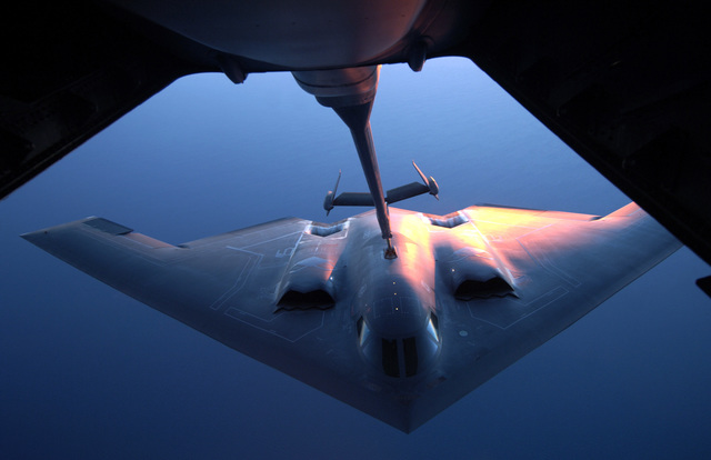 "A U.S. Air Force B-2 Spirit""Stealth""bomber, 36th Expeditionary Wing, conducts an aerial refueling with a KC-10 Extender during exercise Green Lightning, Royal Australian Air Force (RAAF) Base Darwin, Northern Territory, Australia, July 25, 2006. The Exercise will improve the U.S. capabilities and operational familiarity in the region for the Pacific bomber presence and servers to enhance relations with the RAAF. (U.S. Air Force photo by TECH SGT. Shane A. Cuomo) (Released)"