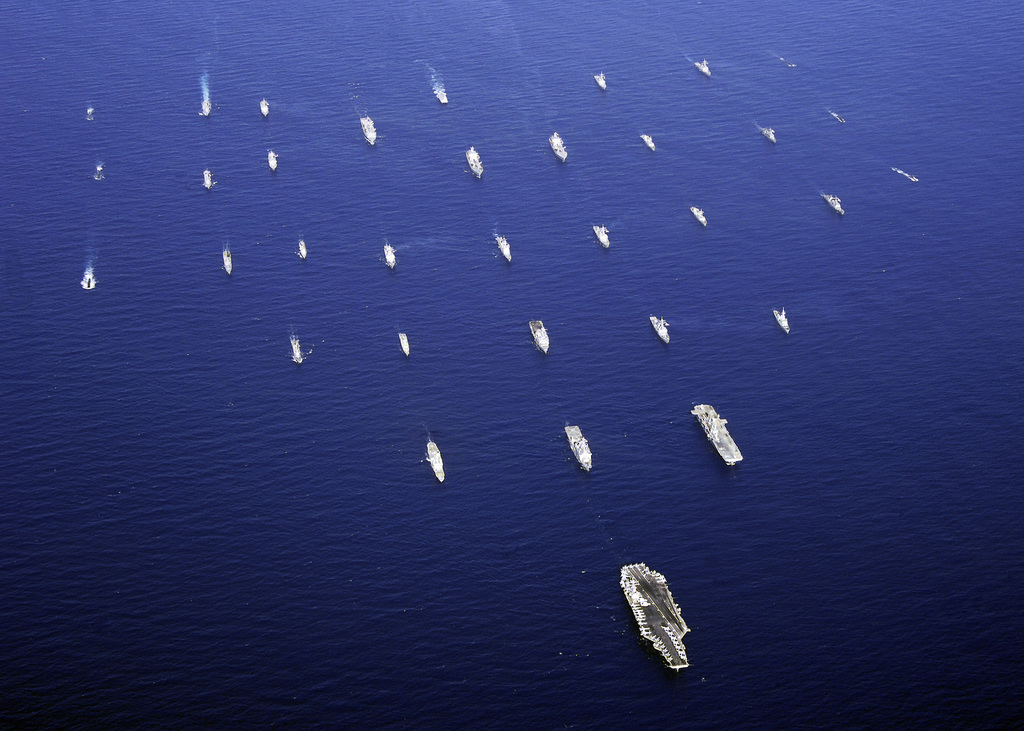 The US Navy (USN) Nimitz Class Aircraft Carrier USS ABRAHAM LINCOLN (CVN 72) leads a formation of ships and submarines, from the USN and the navies of seven other countries, during a photo exercise to commemorate the last day of Exercise RIM OF THE PACIFIC 2006 (RIMPAC 2006), the worlds largest biennial maritime exercise in the Pacific Ocean (POC) involving military forces from the United States (USA), Australia (AUS), Canada (CAN), Chile (CHL), Japan (JPN), Peru (PER), the Republic of Korea (KOR), and the United Kingdom (UK)