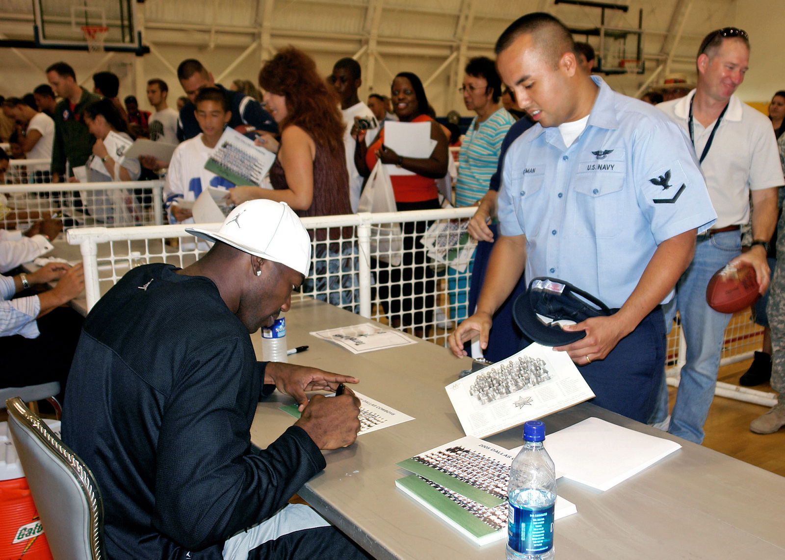 060727-N-9643W-130 (Jul. 27, 2006)Dallas Cowboys wide receiver Terrell Owens, signs an autograph for Personnel SPECIALIST Third Class (PS3) Guillermo Guzman, during the team's visit to Naval Air Station (NAS), Point Mugu, California, (CA).U.S. Navy official photo by Mass Communication SPECIALIST Second Class Kimberly Williams (Released)