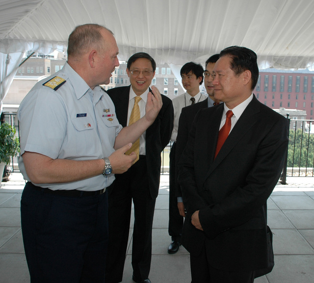 Washington, DC, July 27, 2006 -- Admiral Allen speaks with Minister Zhou  Yongkang, State Councilor; Minister of Public Safety and commissioner of  National Narcotics Control Commission; People's Republic of China, on  the roof of the Hay-Adams Hotel, Washington,D.C. while they waited for the arrival of Secretary Chertoff.  Barry Bahler/DHS