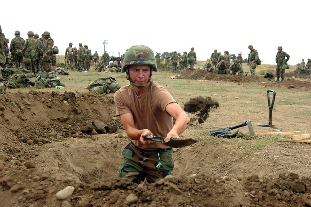 060729-N-0775Y-006 (July 29, 2006)US Navy (USN) Mass Communication SPECIALIST 3rd Class (MC3) Dustin Coveny, from Naval Mobile Construction Battalion 3 (NMCB-3), digs a fighting position during a field exercise at Fort Hunter Ligget, California (CA). More than 350 USN Seabees participated in the event designed to demonstrate their abilities in combat training and command and control.U.S. Navy official photo by Mass Communication SPECIALIST 1ST Class Carmichael Yepez (RELEASED)