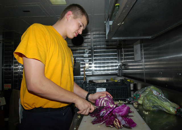 060729-N-7202W-006 (July 29, 2006)US Navy (USN) SEAMAN Brandon Beach, Intelligence SPECIALIST SEAMAN on temporary assigned duty to the supply department prepares red cabbage for the evening meal aboard the USN Wasp Class Amphibious Assault Ship USS IWO JIMA (LHD 7). The IWO JIMA is currently deployed in support of Maritime Security Operations in the Mediterranean Sea region. U.S. Navy photo by Mass Communication SPECIALIST 3rd Class (AW) Amanda M. Williams (Released)