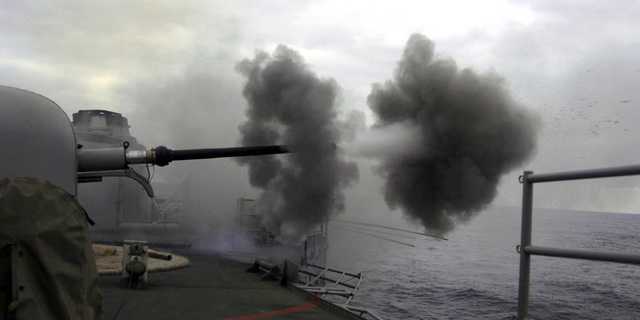 The gun crew aboard the Armada Espanola (Spanish Navy) Santa Maria Class Frigate (FFG) SPS CANARIAS (F 86) fires the OTO Melara 76/62 (76 mm / 62 caliber) Compact Naval Gun Mount gun as it participates in a live-fire gun exercise during the Pacific Ocean (POC) phase of Exercise UNITS 2006, held on the Chilean coast. UNITAS 2006 is an annual exercise that involves naval forces from Chile, Colombia, Ecuador, Mexico, Peru, Spain, and the US training together in a number of maritime scenarios with each national force operating as a component of this multi-national force
