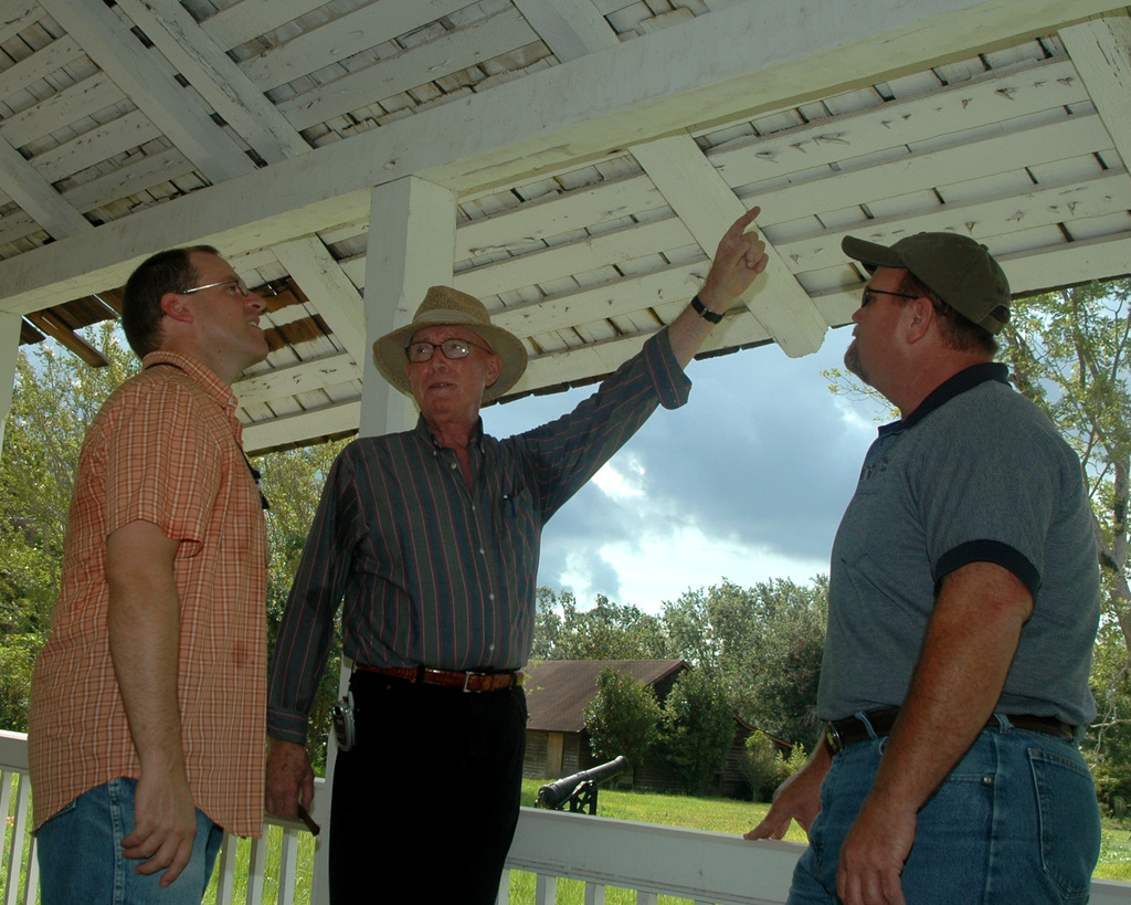 [Hurricane Katrina] Pascagoula, Miss. August 14, 2006 -- FEMA structural engineer Walter Kerley discusses historic reconstruction roofing techniques at the Old Spanish Fort with FEMA archeologist Hugh Mcaloon (L) and Kelly Samples, Jackson County, Miss., special projects coordinator.  Historic preservation assistance from FEMA will return the oldest structure in the Mississippi Valley to its pre-Hurricane Katrina condition.  Michelle Miller-Freeck/FEMA