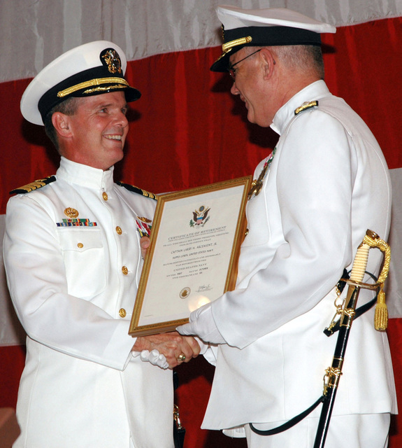 060731-N-3165S-071 (Jul. 31, 2006)US Navy (USN) Rear Adm. Henry B. Tomlin (right) presents CAPT. Larry H. Arcement Jr., former Commanding Officer (CO), Navy Expeditionary Medical Support Command (NEMSCOM), his Certificate of Retirement Command at the US Coast Guard (USCG) Training Center Yorktown, Virginia (VA). CAPT. Arcement retired after 28 years of Naval service.U.S. Navy official photo by Mass Communication SPECIALIST SEAMAN Apprentice Ryan Lee Steinhour (RELEASED)