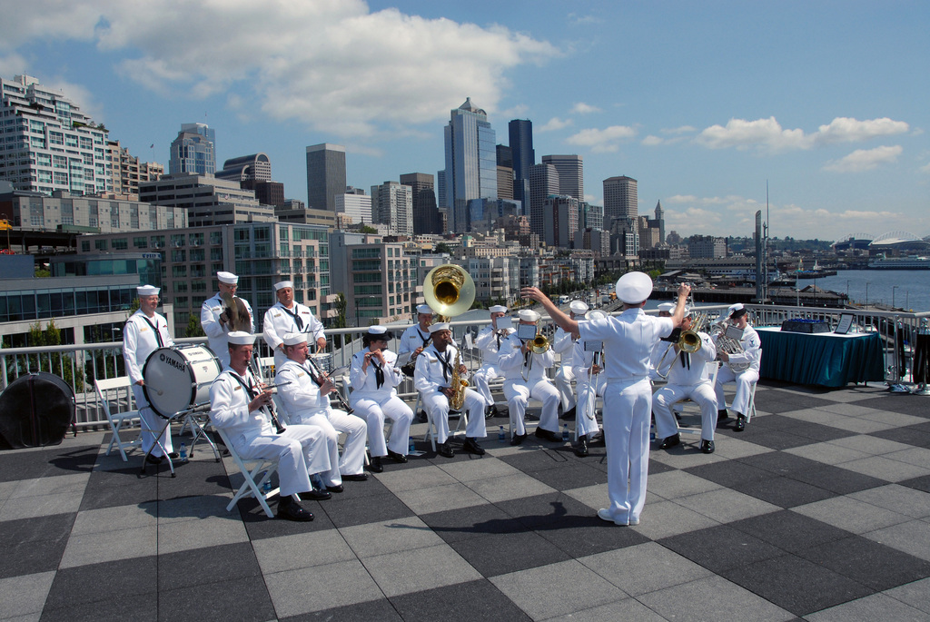 060802-N-3390M-507 (Aug. 2, 2006)The US Navy (USN) Northwest Band plays military music during the Seattle Seafair Parade of Ships in Seattle Washington (WA). The parade marks the beginning of Seafair's Fleet Week by our Sailors, Marines and Coast Guardsmen. U.S. Navy photo by Mass Communication SPECIALIST Third Class Douglas G. Morrison (RELEASED)