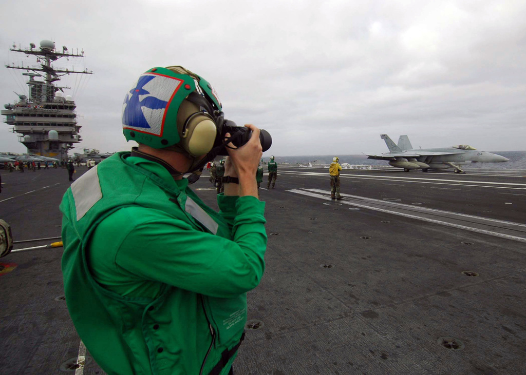 US Navy (USN) Mass Communications SPECIALIST SEAMAN (MCSN) James Evans takes a photo of a USN F/A-18E Super Hornet from the Strike Fighter Squadron 137 (VFA-137) as it takes off from the flight deck of the USN Nimitz Class Aircraft Carrier USS ABRAHAM LINCOLN (CVN 72). The LINCOLN and USN Carrier Air Wing 2 (CVW-2) are completing a deployment in the Pacific Ocean