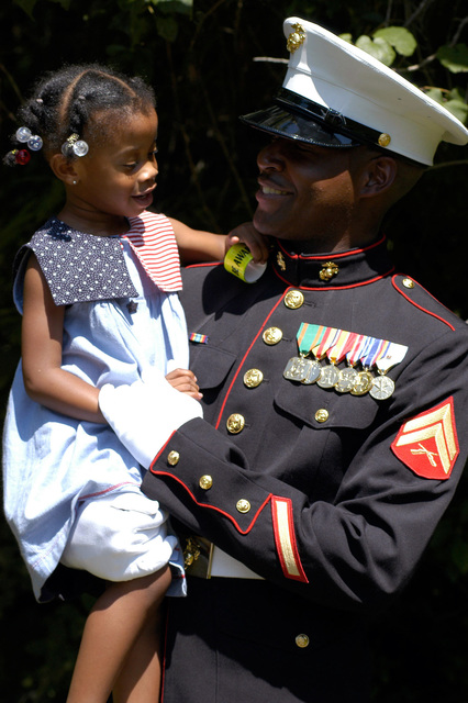 060805-N-6091H-186 (August 5, 2006)US Marine Corps (USMC) Marine CPL. Edward Radcliffe celebrates with his daughter after the dedication of a memorial marker for his kin, Civil War Medal of Honor recipient US Army (USA) SGT. Major Edward Ratcliffe, at Cheesecake Cemetery, Virginia (VA). US Navy (USN) Sailors from Naval Weapons Station Yorktown hosted the event.U.S. Navy official photo by Mass Communication SPECIALIST 3rd Class Chad A. Hallford (RELEASED)