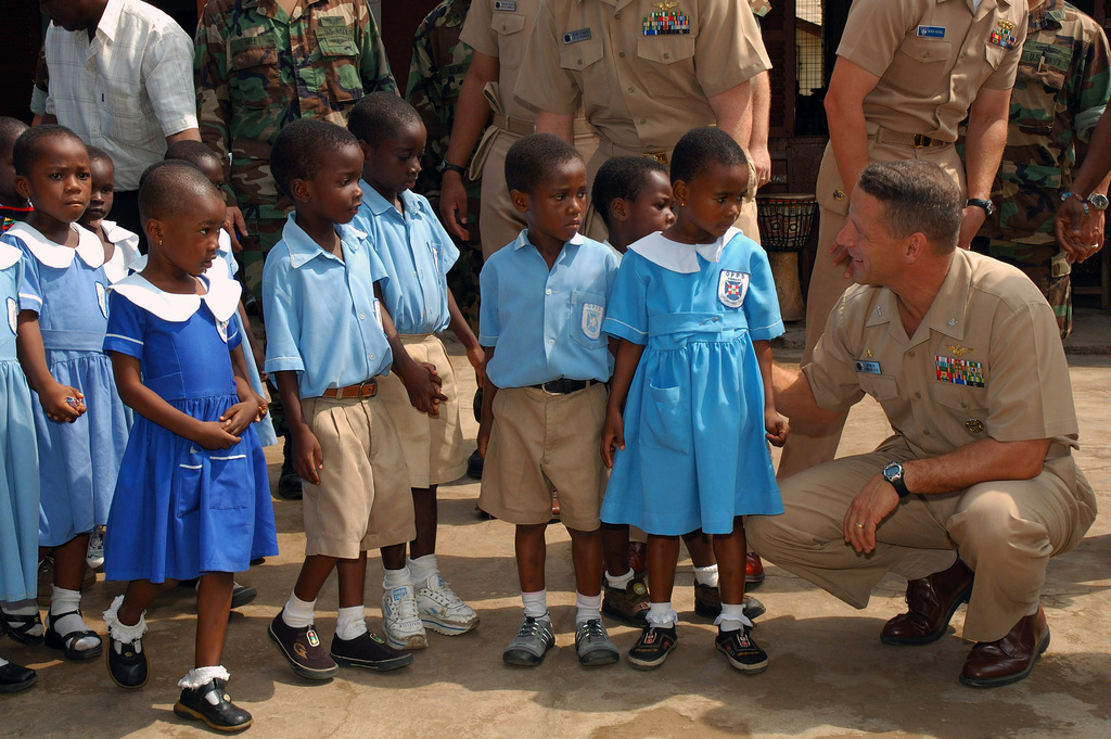 060808-N-5821P-090 (Aug. 8, 2006)US Navy (USN) CAPT. George J. Walter, Jr., Commander, Task Force 67 (CTF-67), speaks with students at the Osu Presbyterian Preparatory School located in Accra, Ghana, at the completion of a Friendship Welcoming Ceremony provided by the school in honor of CTF-67. CTF-67 is conducting a community relations projects at the School to provide much needed landscaping. The Task Force deployment is a part of a larger US interagency effort to continue strengthening relations between Ghana and the world community. U.S. Navy photo by Mass Communication SPECIALIST Second Class Jason T. Poplin (RELEASED)