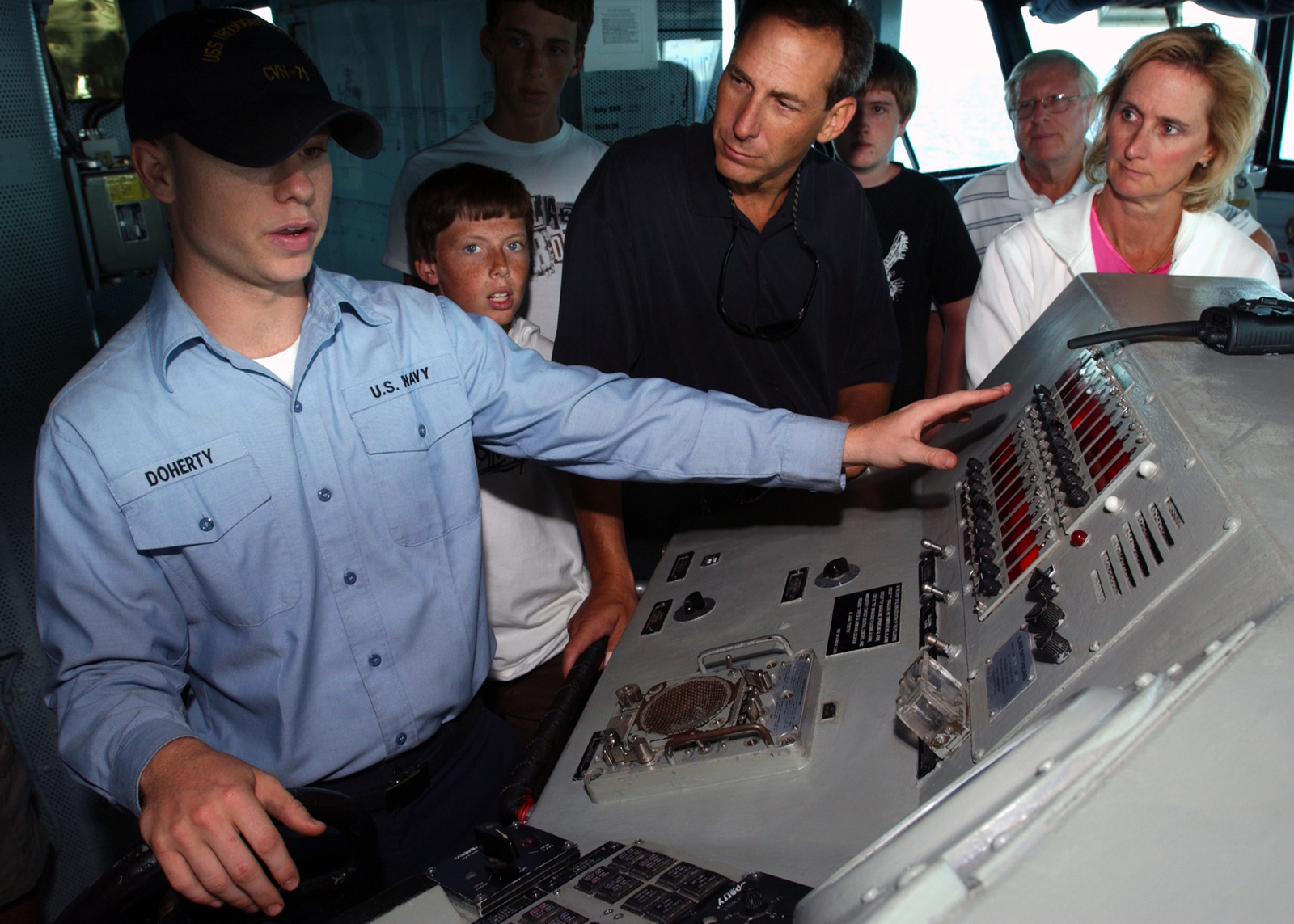 060812-N-0685C-001 (Aug. 12, 2006)US Navy (USN) SEAMAN Doherty (foreground), provides a tour of the bridge on the USN Nimitz Class Aircraft Carrier, USS THEODORE ROOSEVELT (CVN 71) for a Friends And Family Day Cruise. The ROOSEVELT is currently underway in the Atlantic Ocean maintaining qualifications as part of the Fleet Response Plan. U.S. Navy photo by Mass Communication SPECIALIST SEAMAN Javier Capella (RELEASED)