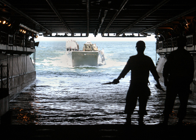 060815-N-3557N-049 (Aug. 15, 2006)US Navy (USN) Landing Craft Utility 1662 (LCU 1662) makes its way into the well deck of the USN Wasp Class Amphibious Assault Ship USS KEARSARGE (LHD 3) as personnel directs this maneuver to off-load equipment and supplies. The KEARSARGE will take part in the Multi-National Exercise PANAMAX 2006. U.S. Navy photo by Mass Communication SPECIALIST SEAMAN Christopher Newsome (Released)