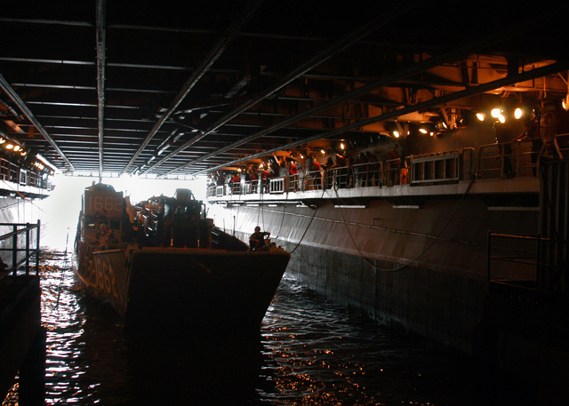 060815-N-3557N-068 (Aug. 15, 2006)A US Navy (USN) Landing Craft Utility 1662 (LCU 1662) makes its way into the well deck of the USN Wasp Class Amphibious Assault Ship USS KEARSARGE (LHD 3) to off-load equipment and supplies.  The KEARSARGE will take part in the Multi-National Exercise Panamax 2006. U.S. Navy photo by Mass Communication SPECIALIST SEAMAN Christopher Newsome (Released)