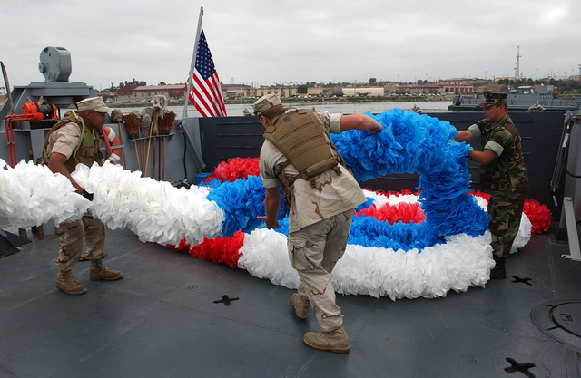 060815-N-49541-283 (Aug. 15, 2006)US Marine Corps (USMC) Marines from Beach Marine Unit 1 (BMU-1), load a large plastic lei on a US Navy (USN) Landing Craft Utility 1633 (LCU 1633). It will be placed upon the bow of the USN Tarawa Class Amphibious Assault Ship USS PELELIU (LHA 5) at its homeport at Naval Station (NS) San Diego, California (CA). The return of USS PELELU (LHA 5) and Expeditionary Strike Group 3 (ESG-3) completes a scheduled six-month deployment to the Persian Gulf. U.S. Navy photo by Mass Communication SPECIALIST 3rd Class Bryan M. Ilyankoff (Released)