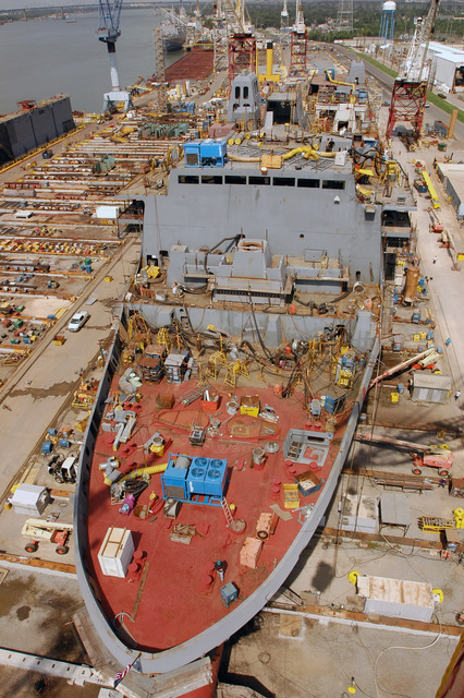 High angle view of the U.S. Navy San Antonio Class Amphibious Transport Dock Ship Pre Commissioning Unit (PCU) NEW YORK (LPD 21) while under construction at the Northrop Grumman Shipyard, Avondale, La., on Aug. 16, 2006. NEW YORK is the fifth ship to be built in the San Antonio Class of amphibious ships. The bow stem is made of steel from the World Trade Centers and weighs 7.5 metric tons. The ship is scheduled to be commissioned in the fall of 2008. (U.S. Navy photo by Mass Communication SPECIALIST SEAMAN Santos Huante) (Released)