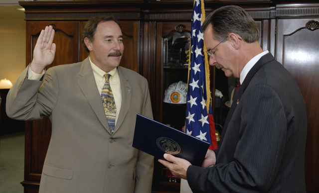 Washington, DC, August 16, 2006 -- Robert Flowers being sworn in as the FEMA Region 8 (Denver, CO) Director by R. David Paulison, the Director of FEMA at FEMA Headquarters.  Bill Koplitz/FEMA