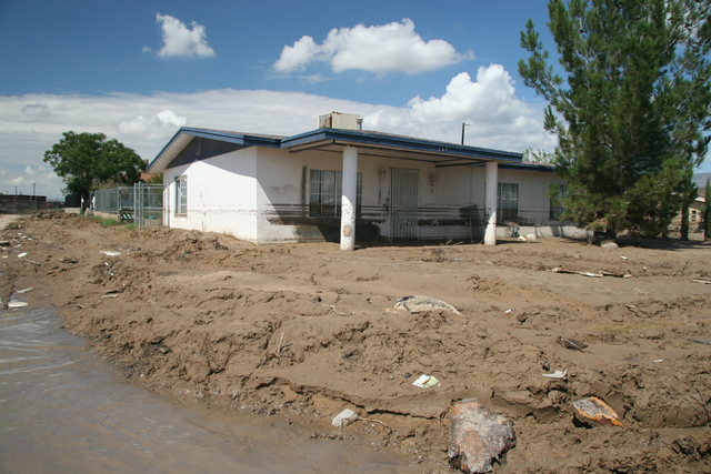 [Flooding] El Paso, TX - This home is surrounded by 2 feet of mud containing large boulders.  Heavy rains in late July left mud and debris in the parts of the city and El Paso County was declared eligible for Federal Disaster aid. Robert J. Alvey/FEMA