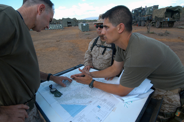 U.S. Navy Hospital Corpsman 2nd Class (FMF/AW) Diego Ponce, right, assists unit members with training for a Fleet Marine Force Warfare pin at Camp Lonestar during Exercise Natural Fire at Nginyang, Kenya, on Aug. 18, 2006. The 10-day multi-lateral field training exercise involves military personnel from East African Community nations, U.S.-based units and Combined Joint Task Force-Horn of Africa. The exercise will focus on crisis response, military-to-military training and humanitarian events that include medical, veterinary and engineering assistance projects. (U.S. Navy photo by Mass Communication SPECIALIST 2nd Class Roger S. Duncan) (Released)(Released)