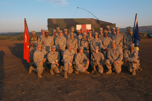 U.S. Navy Sailors from the 4th Medical Battalion gather for a group picture at Camp Lonestar during Exercise Natural Fire at Nginyang, Kenya, on Aug. 18, 2006. The 10-day multi-lateral field training exercise involves military personnel from East African Community nations, U.S.-based units and Combined Joint Task Force-Horn of Africa. The exercise will focus on crisis response, military-to-military training and humanitarian events that include medical, veterinary and engineering assistance projects. (U.S. Navy photo by Mass Communication SPECIALIST 2nd Class Roger S. Duncan) (Released)