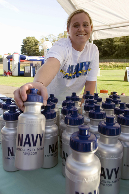 U.S. Navy Hospitalman Karrie Cook, from Branch Medical Clinic, Naval Station Everett, Wash., organizes water bottles at the Navy booth prior to the start of an Everett Aqua Sox baseball game during Military Appreciation Night at Memorial Stadium in Everett on Aug. 19, 2006. The Aqua Sox, a single-A professional baseball team affiliated with the Major League Baseball (MLB) Seattle Mariners, showed their support for America's service members by hosting Military Appreciation Night here. (U.S. Navy photo by Mass Communication SPECIALIST 3rd Class Douglas G. Morrison) (Released)