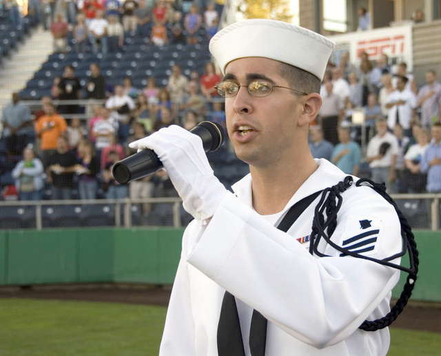 U.S. Navy SEAMAN Cameron Zibicowski, from Naval Station Everett, Wash., sings the National Anthem prior to the start of an Everett Aqua Sox baseball game during Military Appreciation Night at Memorial Stadium in Everett on Aug. 19, 2006. The Aqua Sox, a single-A professional baseball team affiliated with the Major League Baseball (MLB) Seattle Mariners, showed their support for America's service members by hosting Military Appreciation Night here. (U.S. Navy photo by Mass Communication SPECIALIST 3rd Class Douglas G. Morrison) (Released)