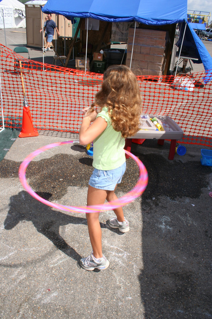 [Hurricane Katrina] D'Iberville, Miss., October 2, 2005  -- A tent city resident displaced by Hurricane Katrina makes her own fun with a hula hoop.  Hurricane Katrina destroyed playgrounds all along the Mississippi Gulf Coast.  Mark Gleokler/FEMA