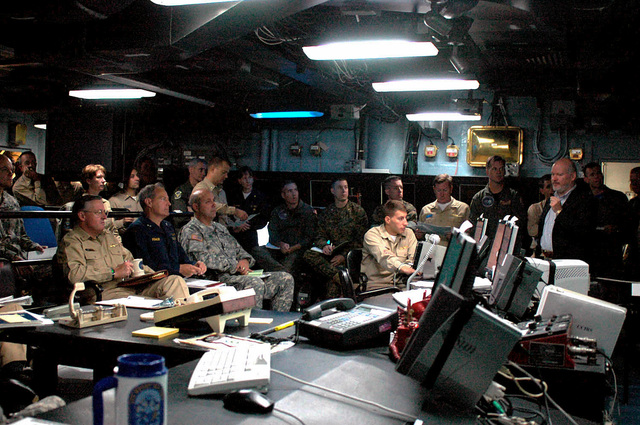 Members of Joint Task Force Lebanon attend the Commander's update briefing in the Joint Operations Center aboard the Blue Ridge Class Amphibious Command Ship USS MOUNT WHITNEY (LCC 20) on Aug. 21, 2006 in the Bay of Gaeta, Italy. The MOUNT WHITNEY is deployed in support of operations in Joint Task Force Lebanon and the Eastern Mediterranean.(U.S. Navy photo by Mass Communication SPECIALIST Second Class Rosa Larson) (Released)