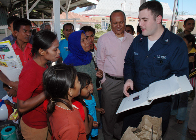 U.S. Navy Hospital Corpsman 3rd Class Christopher Thomas (right), embarked with the Medical Treatment Facility aboard the U.S. Navy Military Sealift Command Mercy Class Hospital Ship USNS MERCY (T-AH 19), explains common English terms and phrases to the local Indonesian residents at Johannes General Hospital, in Kupang, East Nusa Tenggara Province (West Timor), Indonesia, on Aug. 21, 2006. The MERCY is in the fourth month of a five-month humanitarian and civic assistance deployment to Southeast Asia. (U.S. Navy photo by Mass Communication SPECIALIST 1ST Class Michael R. McCormick) (RELEASED)