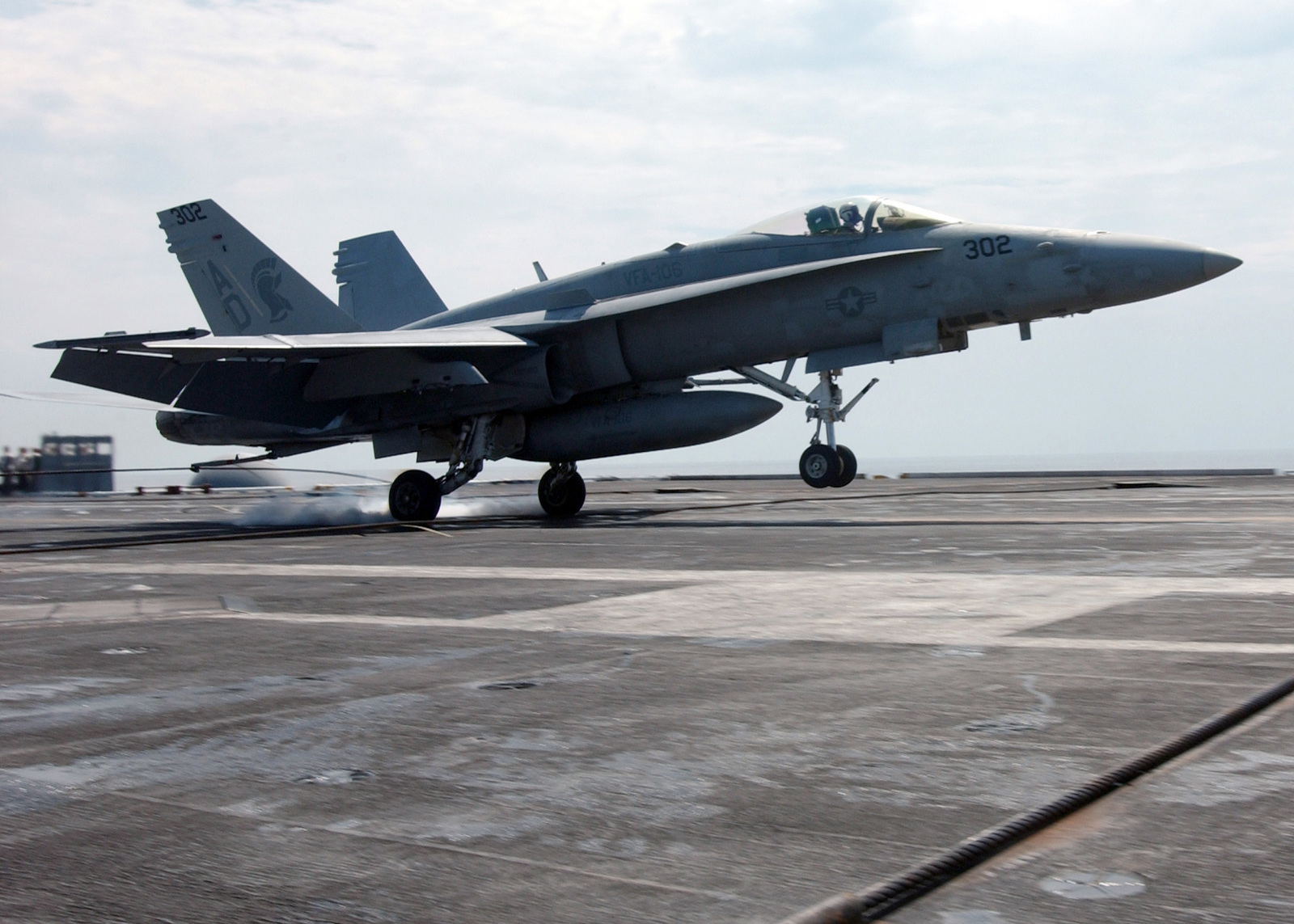 A US Navy F/A-18C Hornet aircraft from Strike Fighter Squadron 106 makes an arrested landing on the flight deck of the Nimitz Class Aircraft Carrier USS THEODORE ROOSEVELT (CVN 71) during operations in the Atlantic Ocean. The Super Hornet is an all-weather, carrier-based fighter/ attack aircraft that provides USN Carrier Strike Group with increased range, endurance and ordnance-carrying capabilities.(U.S. Navy official photo by Mass Communication SPECIALIST 3rd Class Randall Damm) (Released)
