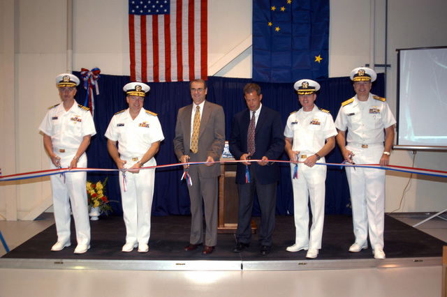 From left, U.S. Navy CAPT. Thomas Eccles, Program Manager and Advance Undersea Systems (PMS 394), Rear Adm. William Timme, Deputy Commander for Undersea Warfare Naval Sea System Command (NAVSEA), Tom Baybrook, SENIOR Vice President Science Applications International Corporation, Robert Kollars, Site Director, CAPT. Mark Thomas, NAVSEA Caderock Division Commander and Rear Adm. William French, Commander Navy Region Northwest, cut a ribbon announcing upgrades made to Navy's Southeast Alaska Acoustic Measurement Facility near Ketchikan, Ark., on Aug. 22, 2006. (U.S. Navy photo by Mass Communication SPECIALIST 3rd Class Angela Grube) (Released)