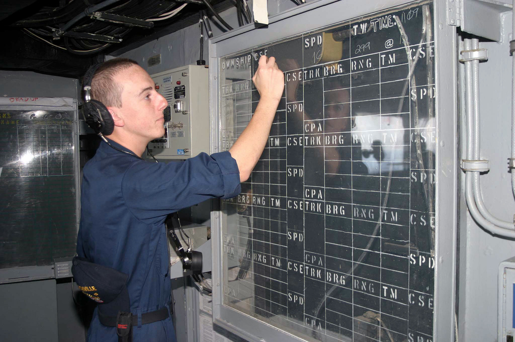 U.S. Navy Operations SPECIALIST Second Class Phillip Montgomery, with the Austin Class Amphibious Transport Dock Ship USS NASHVILLE (LPD 13), updates a status board on Aug. 22, 2006 in the Red Sea. The NASHVILLE is on a regularly scheduled deployment in support of the Global War on Terrorism and Maritime Security Operations.(U.S. Navy photo by Mass Communication SPECIALIST First Class Shonn Moore) (Released)
