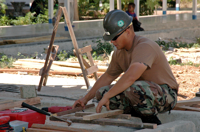 U.S. Navy Utilitiesman 2nd Class Robert Allain, from Naval Mobile Construction Battalion 40, embarked onboard the Military Sealift Command Hospital Ship USNS MERCY (T-AH 19), cuts lumber for constructing benches during a community project at the Johannes General Hospital in Kupang, Indonesia on Aug. 22, 2006. The MERCY is in its fourth month of a five-month humanitarian and civic assistance deployment to South and Southeast Asia. (U.S. Navy photo by Mass Communication SPECIALIST SEAMAN Ryan Clement) (Released)