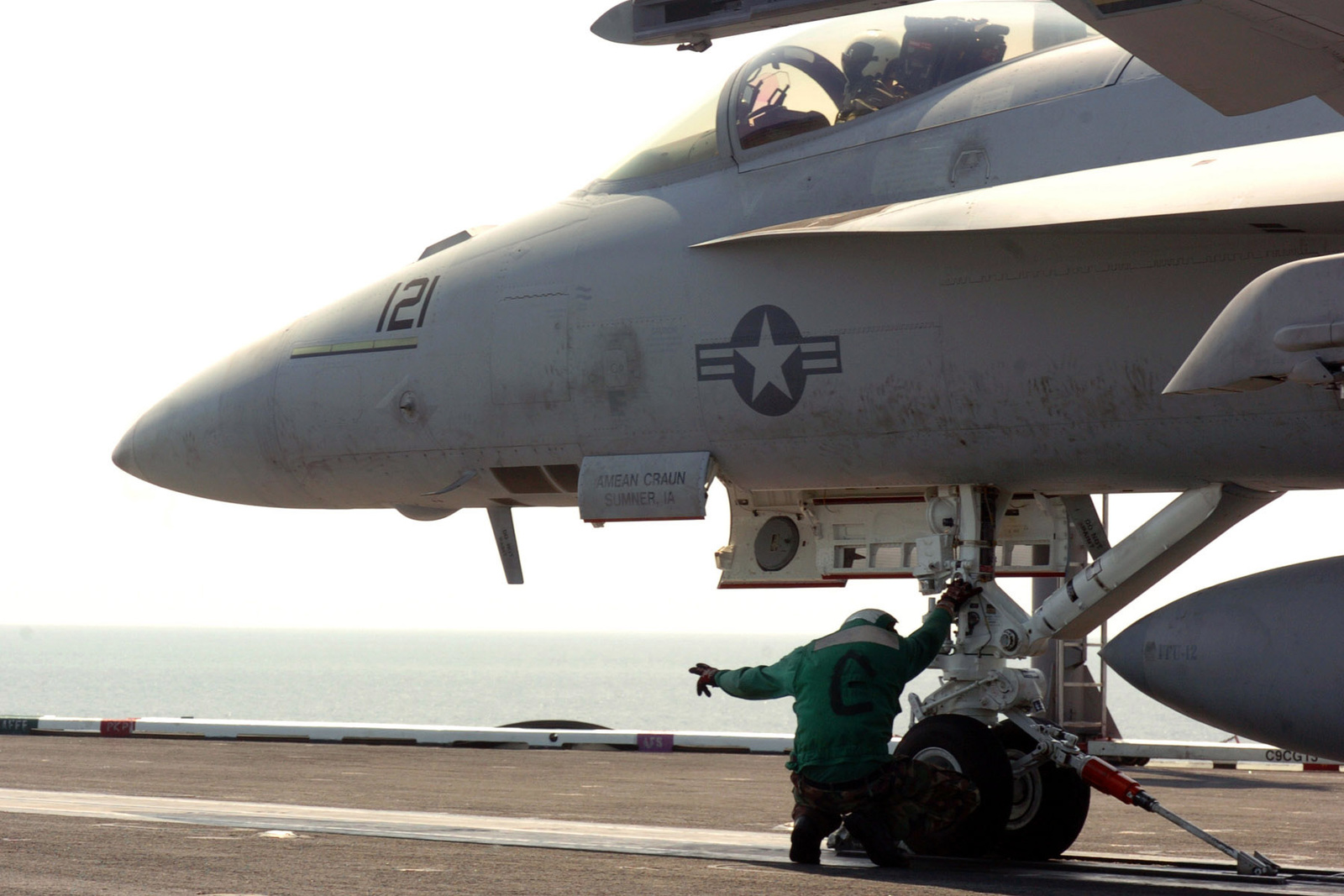 A US Navy flight deck crew member signals to advance the shuttle during the launch of an F/A-18E Super Hornet aircraft from Strike Fighter Squadron 105 after its landing on the flight deck of the Nimitz Class Aircraft Carrier USS THEODORE ROOSEVELT (CVN 71) during operations in the Atlantic Ocean. The Super Hornet is an all-weather, carrier-based fighter/ attack aircraft that provides USN Carrier Strike Group with increased range, endurance and ordnance-carrying capabilities.(U.S. Navy official photo by Mass Communication SPECIALIST SEAMAN Sheldon Rowley) (Released)