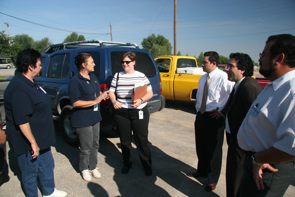 [Flooding] Socorro, Tx - From left, Texas Community Relations (CR) representative Sharalyn Stewart, FEMA CR member Sharalyn Stewart and Congressional Affairs Cindy Wirz visit with Congressman Silvestre Reyes staffers Cesar Blanco, Philip LoPiccolo, and Texas Cooperative Extension representative Jaime Iglesias, Ph.D. The team toured in and around Socorro, visiting with residents who suffered loses from the storms that struck El Paso County in late July/early August. Robert J. Alvey/FEMA